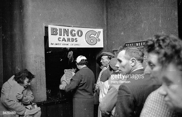 Bingo players queuing for their tickets at a bingo hall in the Essoldo Cinema in Burnt Oak
