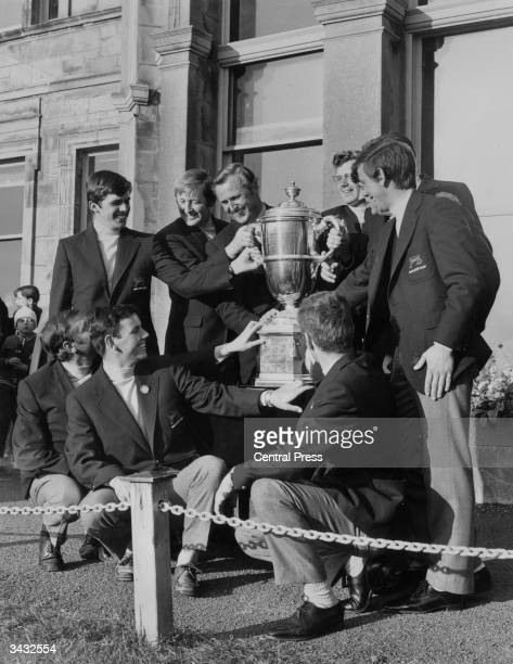 The jubilant British golf team Humphreys, Foster, Bonallack , Marsh, Green, Stuart and Carr, Marks, MacDonald and MacGregor, with the Walker Cup on...
