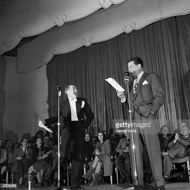 Comedian Bob Hope and Syd Fields on stage at the Prince of Wales Theatre during their middle of the night broadcast to the USA.