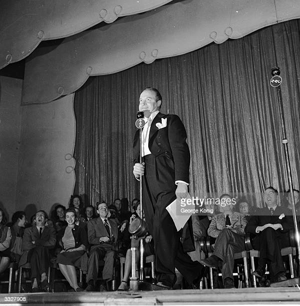 Comedian Bob Hope making his middle of the night broadcast to the USA at the Prince of Wales Theatre.