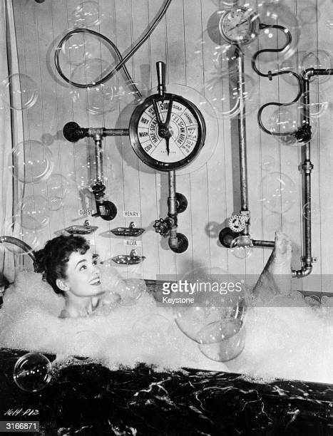 Film star Ann Blyth in a bubble bath with contols pipes and a barometerA scene from the UniversalInternational comedy 'Free For All' which also stars...