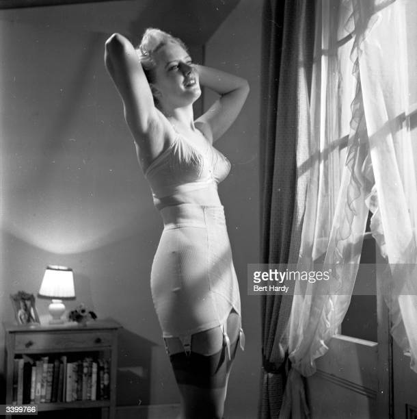 A woman models a new corset from America Cut sarongstyle and completetly boneless it is guaranteed not to 'ride up' Original Publication Picture Post...