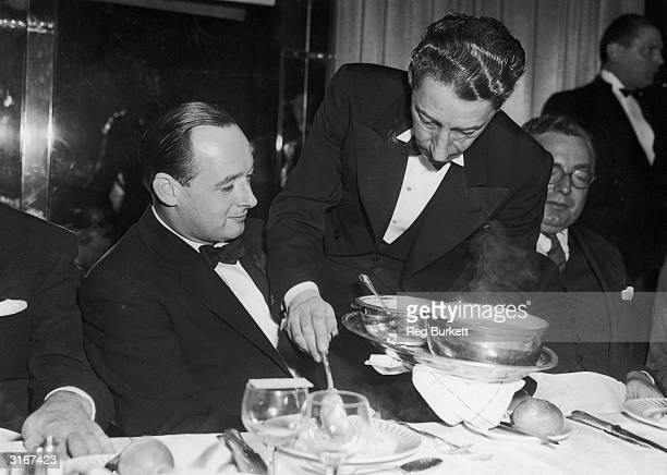Donald Campbell who recently broke the world water speed record is served with soup at a Foyles luncheon at the Dorchester Hotel in London The guest...