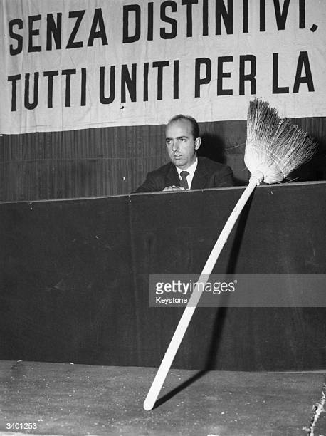 Prince Sforza Ruspoli of Italy addresses disgruntled Italian farmers at a meeting in Milan To his left sits a broom representing the 'broom congress'...