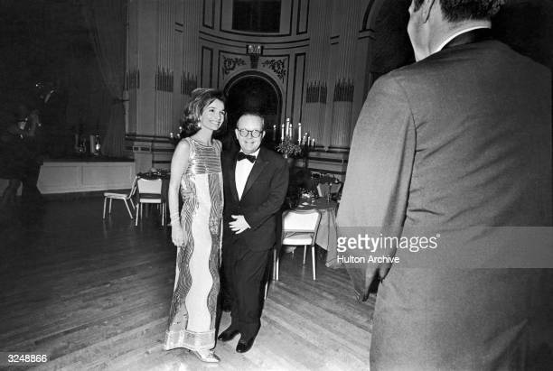 American socialite Lee Radziwill and American writer Truman Capote pose together in the Grand Ballroom of the Plaza Hotel during Capote's...
