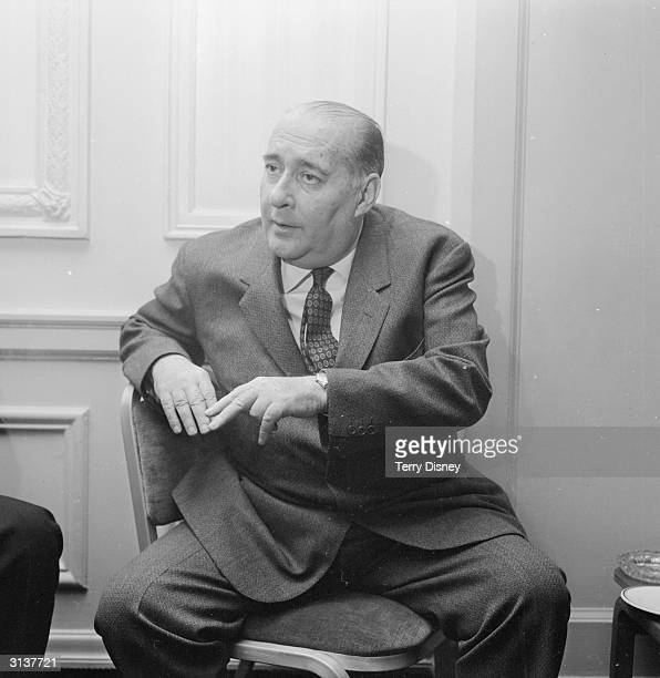Italian film director Roberto Rossellini attends a press conference at the Cafe Royal