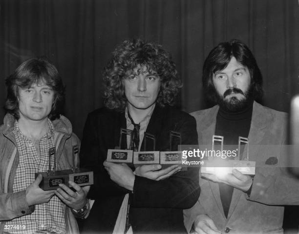 Three members of rock group Led Zeppelin with their seven Melody Maker awards They are from left to right John Paul Jones Robert Plant and John Bonham