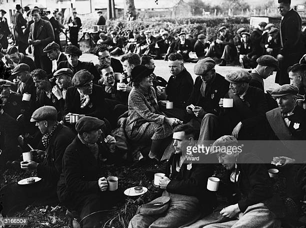 The Jarrow marchers headed by Labour MP Ellen Wilkinson stop for a sandwich near Luton on their way to Parliament to hand in a petition over growing...
