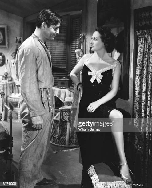Clark Gable and Joan Crawford face to face in a scene from 'Strange Cargo', directed by Frank Borzage.