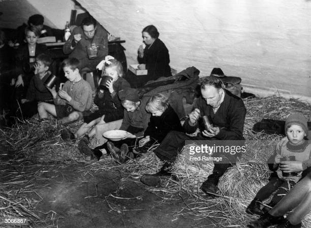 German refugees from Aachen at mealtime in the old German barracks at Brand They are being cared for by Americans