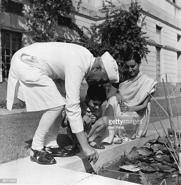 Indian Prime Minister Pandit Nehru with his daughter Indira Gandhi and his grandson Rajiv Original Publication Picture Post 5141 A Voice Above the...