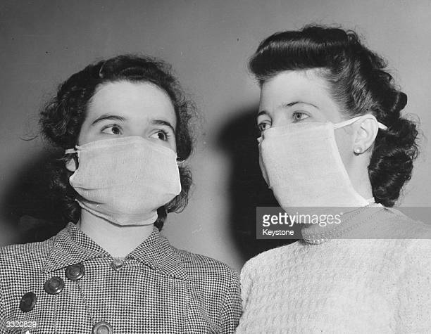 Couple of office workers wearing masks to protect them from the dangerous smog in London.
