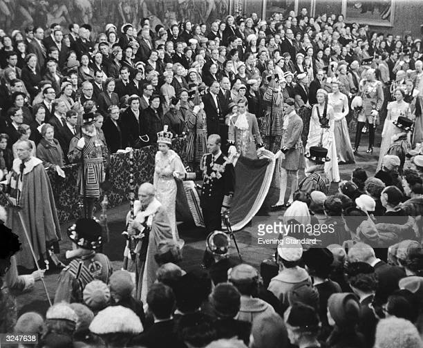 Queen Elizabeth II and Prince Philip return from the chamber after the state opening of Parliament
