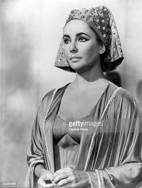 Britishborn film star Elizabeth Taylor wearing one of the sixty costumes specially designed by Irene Sharaff for her role as the Egyptian queen in...