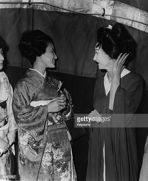 Princess Hanako of Japan the wife of Prince Hitachi admires the hairstyle of Elizabeth Vaughan the principal singer in the Royal Opera House's...