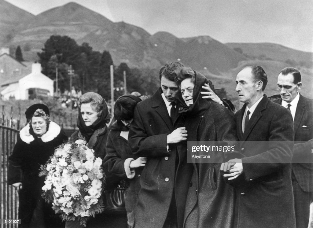 One of the bereaved families at the mass funeral for 81 of the 190 children and adults who died when a collapsed slag heap engulfed Pantglas Junior School at the mining village of Aberfan.