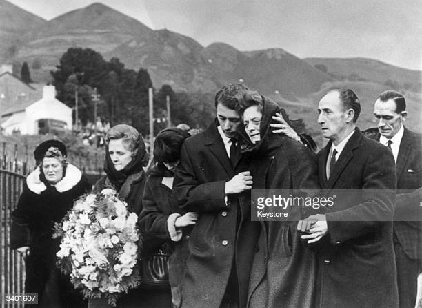 One of the bereaved families at the mass funeral for 81 of the 190 children and adults who died when a collapsed slag heap engulfed Pantglas Junior...