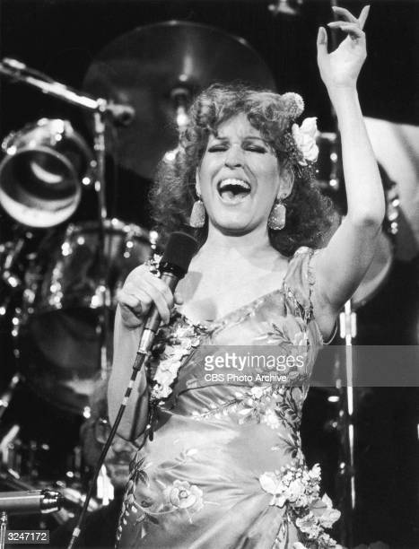 American singer and actor Bette Midler performs on the CBS special 'Rolling Stone The 10th Anniversary' She is wearing a floral print dress