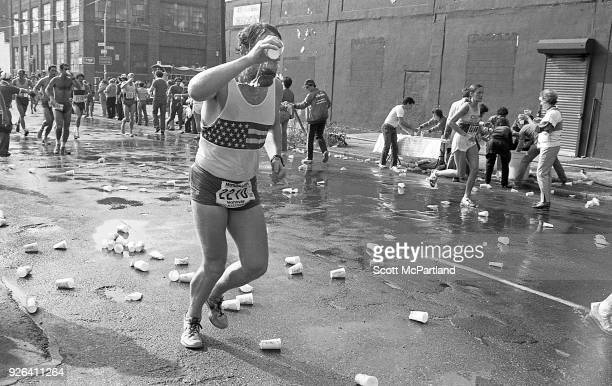New York A runner soaked in sweat pours water over his face to cool off during the NYC Marathon