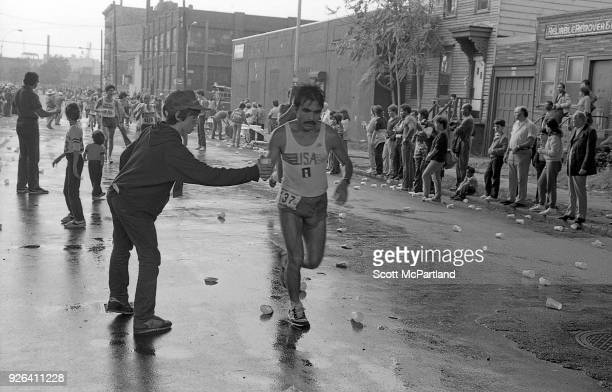 New York A young boy hands a cup of water to a runner at the 10 mile mark on Bedford Avenue in Williamsburg Brooklyn during the NYC Marathon