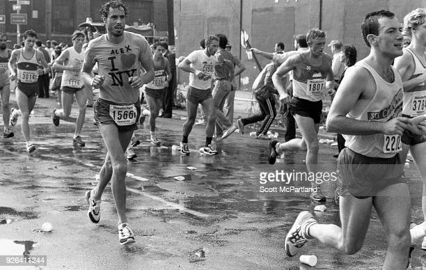 New York Dozens of runners drenched in sweat cross the 10 mile mark on Bedford Avenue in Williamsburg Brooklyn during the NYC Marathon