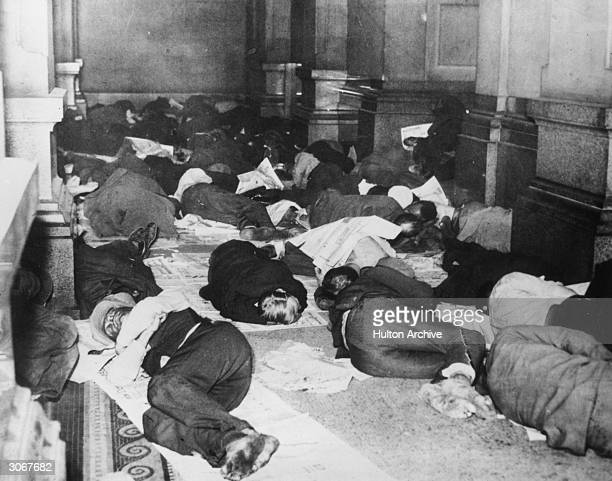Unemployed citizens of Philadelphia sleeping in the corridors of City Hall to escape the cold weather.