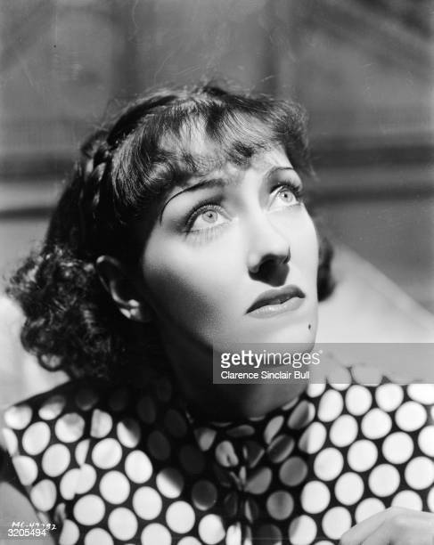 American actress Gloria Swanson casts a worried glance upwards