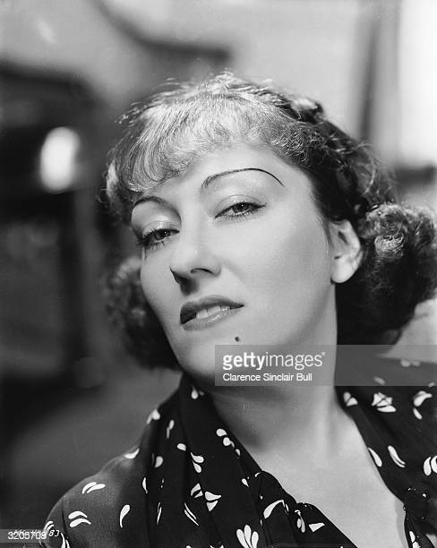 American actress Gloria Swanson sneers seductively at the camera