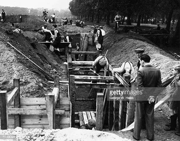 Workmen digging trenches in Hyde Park, London.
