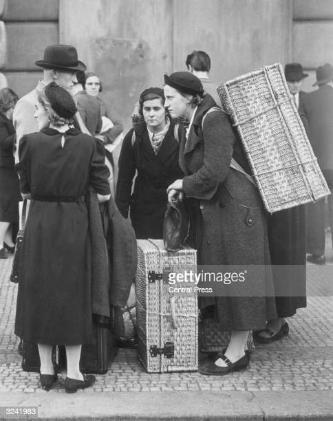 Refugees arriving in Prague after leaving their homes in the Sudetenland a region with a large ethnic German population which was the object of...