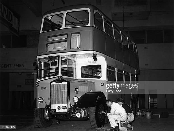 A bus with fluorescent lighting at the Commercial Motor Transport Show at Earls Court in London just before it opened to the public The vehicle built...