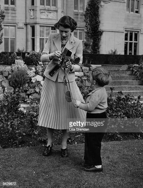 Queen Elizabeth and her son Charles playing with a camera in the grounds of Balmoral Castle Scotland