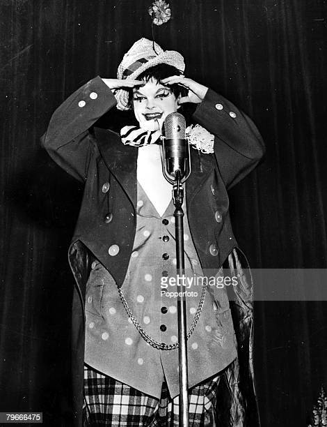 28th September 1956 Exuberant actress Judy Garland strikes a pose in her clown costume as she appears at the opening performance of her All star...