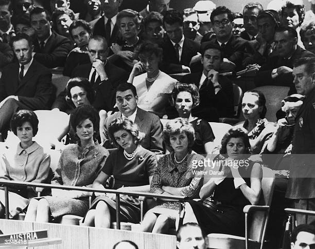 View of an audience assembled to hear John F Kennedy speak at the United Nations, New York City. Pictured are: Jean Kennedy, Jacqueline Kennedy,...