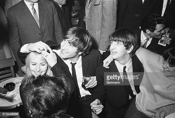 2/9/1964New York NY John Lennon the only married member of the Beatles enjoys a night out with his wife Cynthia after appearing with the other three...