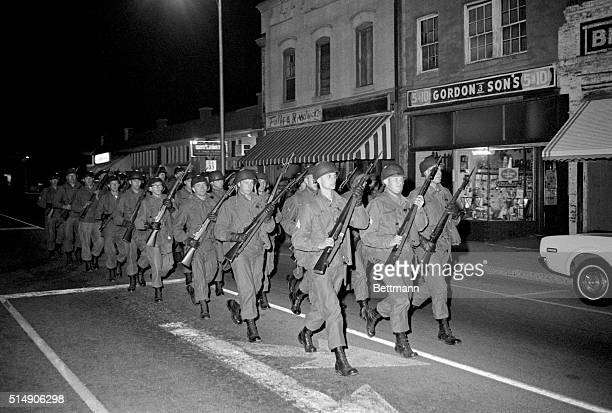 2/9/1968Orangeburg SC National Guardsmen with rifles and fixed bayonets march doubletime 2/8 night to back up South Carolina Highway Patrolmen who...