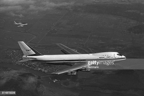 2/9/69Everett Washington The world's larget commercial jetliner the Boeing 747 a 231 foot mammoth of the skies makes the F86 chase plane look like a...