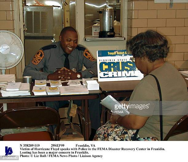 N 358289 019 29Sep99 Franklin Va Victim Of Hurricane Floyd Speaks With Police In The Fema Disaster Recovery Center In Franklin Looting Has Been A...