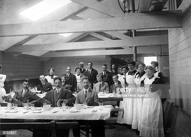 Stewards in a dining room wait to attend the inquiry into the sinking of the 'Titanic'