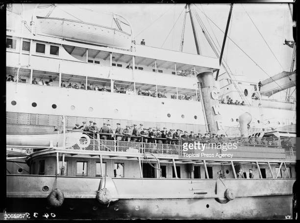 Survivors of the Titanic disaster board a GWR ferry at Plymouth after arriving in England on the SS Lapland