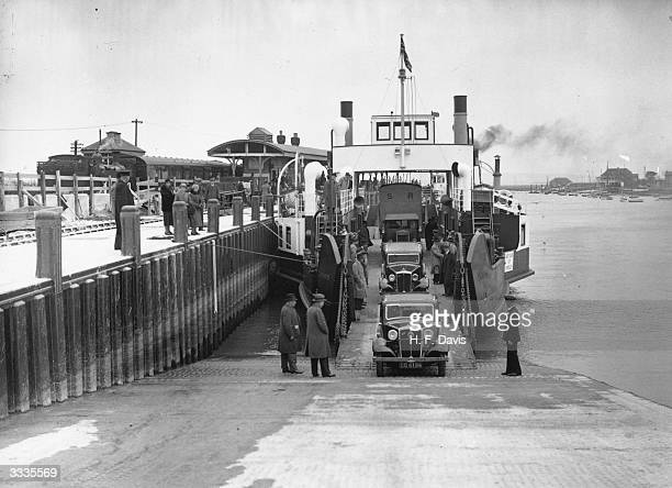 Cars disembark from the new motor ferry, the Lymington, after a crossing to Yarmouth on the Isle of Wight. The ferry employs the new Voith-Schneider...