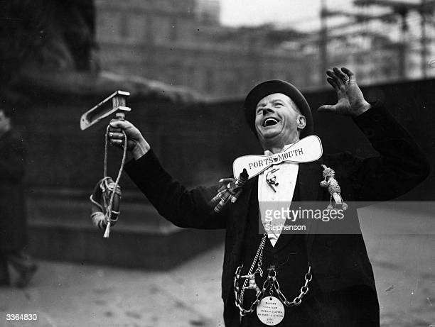 A Portsmouth Football Club supporter cheering his team in Trafalgar Square London before their FA Cup Final match against Wolverhampton Wanderers at...