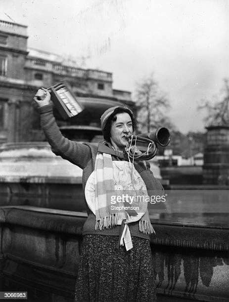A Portsmouth soccer supporter in Trafalgar Square London blows a horn and waves a rattle She is in London to watch an FA Cup match