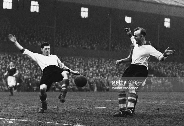 Robert Paisley on the left plays for Liverpool with his goalkeeper, Sidlow watching in their cup match against Burnley. Original Publication: Picture...