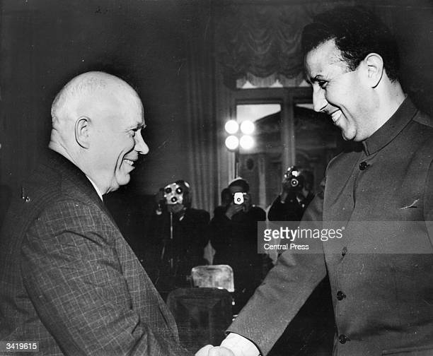 Algerian president Ahmed Ben Bella greeting Soviet politician Nikita Sergeyevich Khrushchev on arrival at Moscow