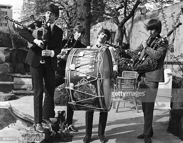 The British rock group The Beatles perform on bagpipes and marching drum outdoors to promote their concerts in the Scottish cities of Glasgow and...