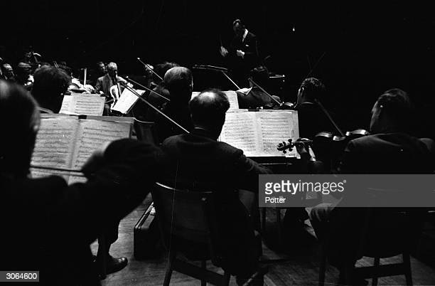 Sir Malcolm Sargent conducts the London Symphony Orchestra during a rehearsal at the Royal Albert Hall London