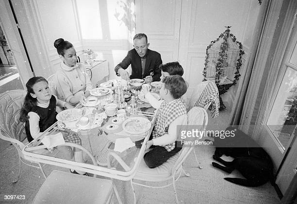 American dancer and actor Bing Crosby at his home in San Francisco with his sons Nathaniel and Harry and his daughter Mary