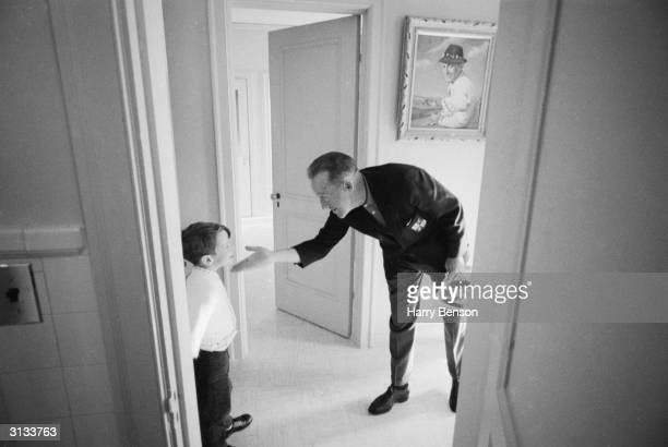 American dancer and actor Bing Crosby at his home in San Francisco with his son