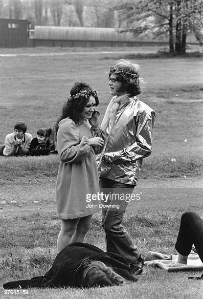 A young hippy couple relaxing in the grounds of Alexandra Palace London after attending the 14 hour Technicolour Dream a festival in aid of The...